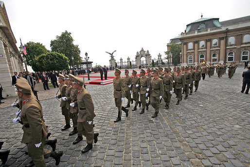Hungarian troops march in front of Sandor Palace during an arrival ceremony for President George W. Bush in Budapest, Hungary, Thursday, June 22, 2006. White House photo by Eric Draper
