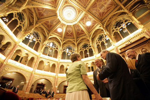 President George W. Bush talks with Hungarian political leaders inside the conference hall of the Hungarian Parliament building in Budapest, Hungary, Thursday, June 22, 2006. White House photo by Eric Draper