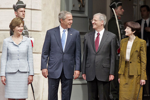 President George W. Bush, Mrs. Laura Bush, Hungarian President Laszlo Solyom and Mrs. Erzsebet Solyom participate in an official arrival ceremony at Sandor Palace in Budapest, Hungary, June 22, 2006. White House photo by Paul Morse