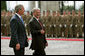 Hungarian President Laszlo Solyom and President George W. Bush review the Hungarian troops during an arrival ceremony at Sandor Palace in Budapest, Hungary, Thursday, June 22, 2006. White House photo by Shealah Craighead
