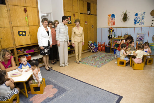 Mrs. Laura Bush and Dr. Klara Dobrev, wife of Hungarian Prime Minister Ferenc Gyurcsanys, visit the United Daycare of Jozsefvarosi in Budapest, Hungary, Thursday, June 22, 2006. White House photo by Shealah Craighead
