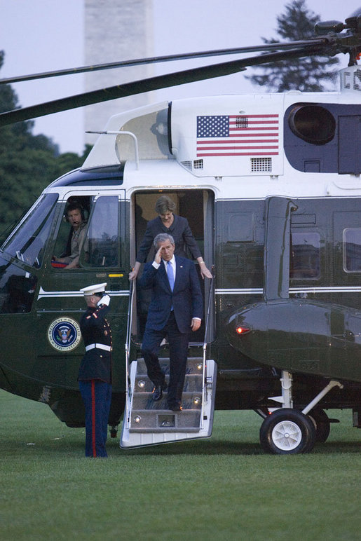 President George W. Bush and Laura Bush arrive via Marine One on the South Lawn of the White House Thursday, June 22, 2006, after a three-day European visit to Vienna and Budapest. White House photo by Kimberlee Hewitt