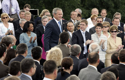 "President George W. Bush walks to the podium to deliver remarks from Gellert Hill in Budapest, Hungary, Thursday, June 22, 2006. ""Laura and I are honored to visit your great nation,"" said President Bush. ""Hungary sits at the heart of Europe. Hungary represents the triumph of liberty over tyranny, and America is proud to call Hungary a friend."" White House photo by Paul Morse"
