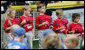 Members of the McGuire AFB Little League Yankees hold their caps over their hearts during the playing of National Anthem at the opening Tee Ball game of the 2006 season on the South Lawn of the White House, Friday, June 23, 2006. The McGuire AFB Yankees played the Dolcom Little League Indians of the Naval Submarine Base from Groton, Ct. White House photo by Eric Draper