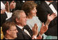 President George W. Bush and Mrs. Laura Bush join the audience in applauding the entertainment Sunday evening, June 25, 2006, at the annual Ford's Theater gala to benefit the historic theater. The program,