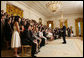President George W. Bush takes a question from one of the 2006 Presidential Scholars in the East Room Monday, June 26, 2006. The program was established in 1964, and recognizes up to 141 distinguished graduating high school seniors. White House photo by Paul Morse