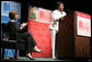Mrs. Laura Bush applauds Caitlyn Clarke, high school Student of the Year for Jefferson Parish Public School System, Monday, June 26, 2006, as Miss Clarke speaks of her passion for reading before introducing Mrs. Bush during the 2006 American Library Association Conference in New Orleans, Louisiana. White House photo by Shealah Craighead