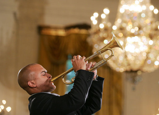 Composer and trumpeter Irvin Mayfield performs in the East Room of the White House Monday, June 26, 2006, as part of the Black Music Month celebration focusing on the music of the Gulf Coast: Blues, Jazz and Soul. White House photo by Eric Draper