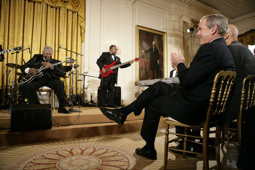 Legendary Blues guitarist B.B. King is applauded by President George W. Bush during King's performance in the East Room of the White House Monday, June 26, 2006, as part of the Black Music Month celebration focusing on the music of the Gulf Coast: Blues, Jazz and Soul. White House photo by Eric Draper
