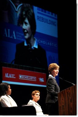 Mrs. Laura Bush flanked by Caitlyn Clarke, left, and Leslie Berger, ALA president-elect, Monday, June 26, 2006, announced that the Institute of Museum and Library Services' Librarians for the 21st Century Program is awarding more than $20 million to support almost 3,900 library-science students at 35 universities, during the 2006 American Library Association Conference in New Orleans, Louisiana. White House photo by Shealah Craighead