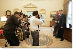 President George W. Bush meets with U.S. Army Staff Sergeant Christian Bagge, 23, of Eugene, Ore., in the Oval Office Tuesday, June 27, 2006. Mr. Bagge lost both legs to a roadside bomb in Iraq while serving in Operation Iraqi Freedom. After their meeting, the two ran together on the South lawn. White House photo by Eric Draper