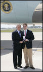 President George W. Bush presents the 2006 Presidential Scholars medal to Andrew Benecke, 18, Wednesday, June 28, 2006 at Lambert Field in St. Louis, Mo. Benecke was unable to attend the awards ceremony in Washington earlier this month because he was undergoing chemotherapy in his fight against bone cancer. White House photo by Kimberlee Hewitt