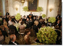 President George W. Bush addresses his welcoming remarks to invited guests Thursday evening, June 29, 2006, during an official dinner in the State Dining Room at the White House in honor of Japanese Prime Minister Junichiro Koizumi's visit to the United States. White House photo by Paul Morse