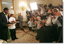 White House Executive Chef Cristeta Comerford discusses the evening's menu with the press in the State Dining Room Thursday, June 29, 2006. The entrée for the dinner is Texas Kobe Beef with cracked black pepper, shitake mushroom jus, silver corn pilaf and sesame-coated wild asparagus.  White House photo by Shealah Craighead