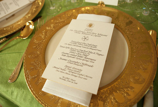 A place setting of the Clinton State Service is on display during the preview of the table setting for the official dinner honoring His Excellency Junichiro Koizumi, Prime Minister of Japan, in the State Dining Room Thursday, June 29, 2006. The tables are draped with jasmine green silk tablecloths. The floral centerpieces are comprised of pave spheres of green cymbidium orchids. White House photo by Shealah Craighead