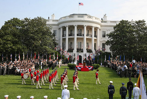 The U.S. Army Old Guard Fife and Drum Corps marches across the South Lawn during the official arrival ceremony for Prime Minister Junichiro Koizumi of Japan Thursday, June 29, 2006. White House photo by Kris Tripplaar