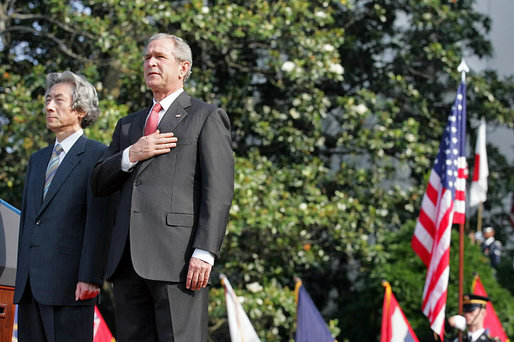 President George W. Bush and Prime Minister Junichiro Koizumi of Japan stand for the playing of the two countries' national anthems during the arrival ceremony on the South Lawn Thursday, June 29, 2006. White House photo by Shealah Craighead