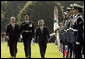 "President George W. Bush and Prime Minister Junichiro Koizumi of Japan review the troops during an arrival ceremony on the South Lawn Thursday, June 29, 2006. ""Japan is now the third largest donor nation for reconstruction efforts in Afghanistan,"" said President Bush in his address. ""In Iraq, Japanese self-defense forces have helped improve the lives of citizens in a key Iraqi province that will soon return to Iraqi control."" White House photo by Paul Morse"