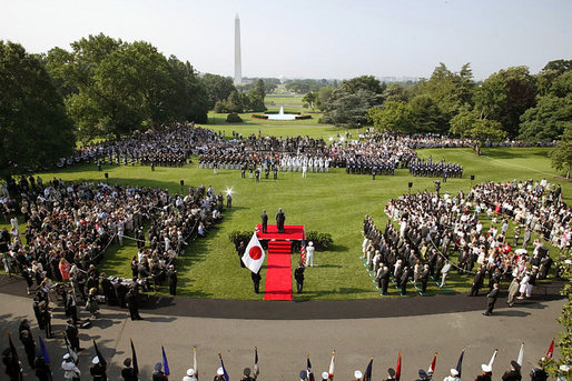 "Prime Minister Junichiro Koizumi of Japan delivers his remarks during the arrival ceremony on the South Lawn Thursday, June 29, 2006. ""I believe it is no exaggeration to say that over the past five years, there has been no world leader, alongside Mr. Bush -- President Bush, among the world leaders with whom I have felt so much heart-to-heart, felt so deep a friendship and trust and have cooperated with,"" said the Prime Minister in his remarks. White House photo by Paul Morse"