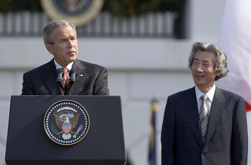 "President George W. Bush delivers an address during an arrival ceremony for Prime Minister Junichiro Koizumi of Japan on the South Lawn Thursday, June 29, 2006. ""Decades ago, our two fathers looked across the Pacific and saw adversaries, uncertainty and war,"" said President Bush. ""Today their sons look across that same ocean and see friends and opportunity and peace."" White House photo by Paul Morse"