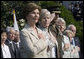 Mrs. Laura Bush stands with Lynne Pace and her husband, Chairman of the Joint Chiefs of Staff General Peter Pace, during the official arrival ceremony for Prime Minister Junichiro Koizumi of Japan on the South Lawn Thursday, June 29, 2006. White House photo by Eric Draper