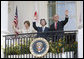 President George W. Bush, Laura Bush and Prime Minister Junichiro Koizumi of Japan wave from the South Portico Balcony at the conclusion of the official arrival ceremony Thursday, June 29, 2006. White House photo by Eric Draper