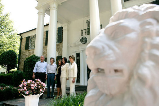 President George W. Bush, Laura Bush and Japanese Prime Minister Junichiro Koizumi are welcomed to Graceland, the home of Elvis Presley, by his former wife Priscilla Presley and their daughter Lisa-Marie Presley, Friday, June 30, 2006 in Memphis. White House photo by Eric Draper
