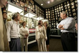 President George W. Bush, Laura Bush and Japanese Prime Minister Junichiro Koizumi are given a tour of Graceland, the home of Elvis Presley, by his former wife Priscilla Presley and their daughter Lisa-Marie Presley, Friday, June 30, 2006 in Memphis. White House photo by Eric Draper