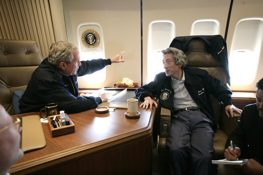 President George W. Bush and Japan's Prime Minister Junichiro Koizumi talk together on Air Force One Friday, June 30, 2006, as they fly to visit Graceland in Memphis. White House photo by Eric Draper
