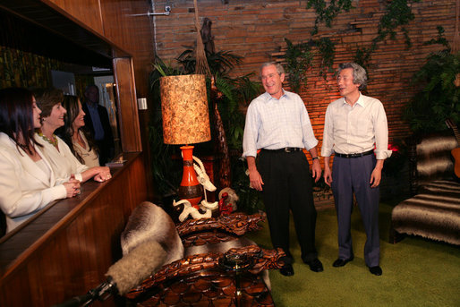 President George W. Bush and Japanese Prime Minister Junichiro Koizumi share a laugh in the Jungle Room while Laura Bush, Priscilla Presley and daughter Lisa-Marie Presley look on, Friday, June 30, 2006, in Memphis, Tennessee, during a tour of Graceland, the home of Elvis Presley. White House photo by Shealah Craighead
