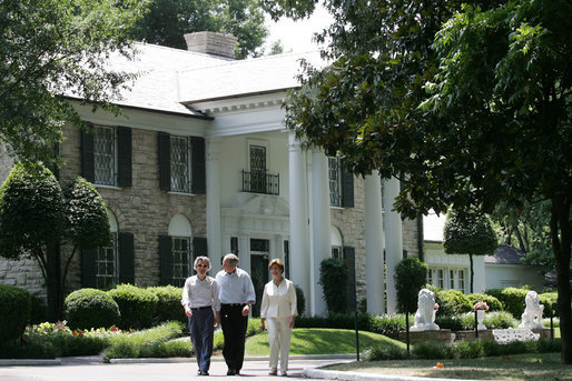 President George W. Bush, Laura Bush and Japanese Prime Minister Junichiro Koizumi, wearing a pair of Elvis-style sunglasses, tour the grounds of Graceland, the home of Elvis Presley, Friday, June 30, 2006, in Memphis. White House photo by Shealah Craighead