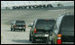 The motorcade of Vice President Dick Cheney takes a lap around the Daytona International Speedway in Daytona, Fla., Saturday, July 1, 2006, as the Vice President arrived to attend the 2006 Pepsi 400 NASCAR race. White House photo by David Bohrer