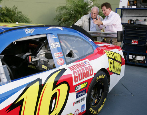 Vice President Dick Cheney is shown the National Guard NASCAR racing car by former NASCAR driver and Winston Cup champion Darrell Waltrip Saturday, July 1, 2006, prior to the start of the 2006 Pepsi 400 race at Daytona International Speedway in Daytona, Fla. White House photo by David Bohrer