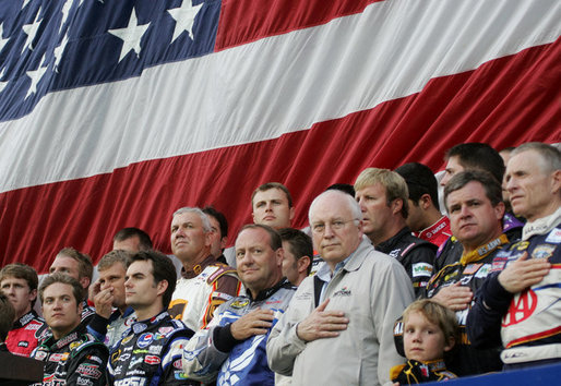 Vice President Dick Cheney joins NASCAR drivers during the playing of the National Anthem Saturday, July 1, 2006, prior to the start of the 2006 Pepsi 400 NASCAR race at Daytona International Speedway in Daytona, Fla. White House photo by David Bohrer