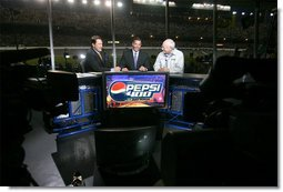 Vice President Dick Cheney talks with Chris Myers, left, and Jeff Hammond, center, of Fox Sports Network, Saturday, July 1, 2006, during a live TV interview held during the 2006 Pepsi 400 NASCAR race at Daytona International Speedway in Daytona, Fla.  White House photo by David Bohrer