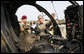 President George W. Bush is shown a helicopter Tuesday, July 4, 2006, during his Independence Day visit to Fort Bragg in North Carolina, where he addressed troops and met with the U.S. Army Special Operations Command. White House photo by Paul Morse