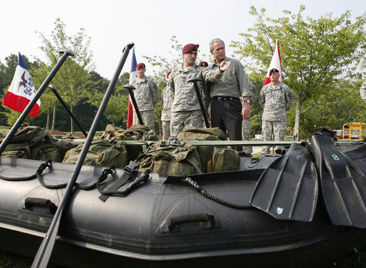President George W. Bush is shown a fully-equipped combat raiding craft Tuesday, July 4, 2006, during his Independence Day visit to Fort Bragg in North Carolina, where he addressed troops and met with the U.S. Army Special Operations Command. White House photo by Paul Morse