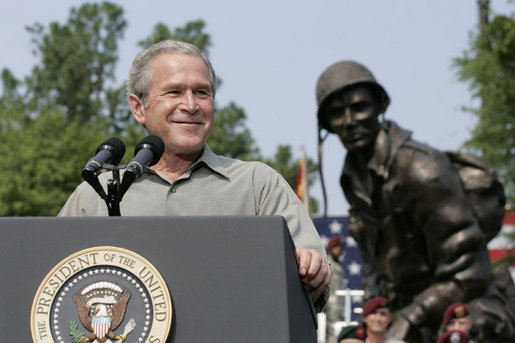 President George W. Bush reacts to applause during his remarks to U.S. troops and their family members Tuesday, July 4, 2006, during an Independence Day celebration at Fort Bragg in North Carolina. President Bush thanked the troops and their families for their service to the nation. White House photo by Paul Morse