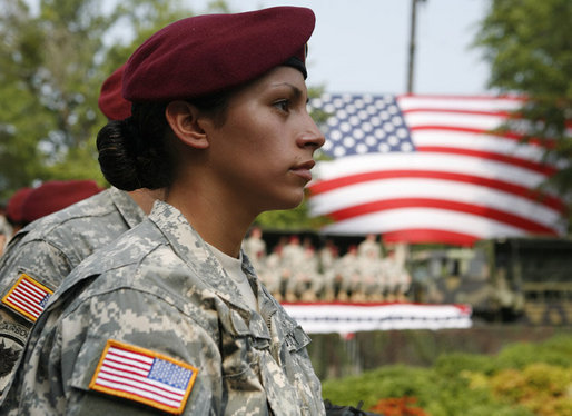 A U.S. Army Airborne soldier listens to President George W. Bush address troops and their family members Tuesday, July 4, 2006, during an Independence Day celebration at Fort Bragg in North Carolina. White House photo by Paul Morse