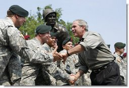 President George W. Bush meets U.S. Airborne and Special Forces troops following his remarks Tuesday, July 4, 2006, during an Independence Day celebration at Fort Bragg in North Carolina. President Bush thanked the troops and their families for their service to the nation. White House photo by Paul Morse