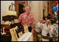 President George W. Bush is presented with a birthday cake Tuesday evening, July 4, 2006, during a dinner party at the White House. President Bush will celebrate his 60th birthday on Thursday. White House photo by Shealah Craighead