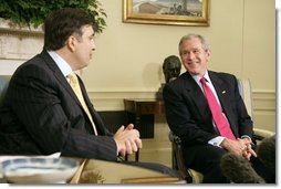 "President George W. Bush and Georgian President Mikhail Saakashvili talk to the press in the Oval Office Wednesday, July 5, 2006. ""He believes in the universality of freedom. He believes that democracy is the best way to yield the peace. The Georgian government and the people of Georgia have acted on those beliefs,"" said President Bush. ""I want to thank you for your contribution in Iraq, to help the Iraqi people realize the great benefits of democracy.""  White House photo by Kimberlee Hewitt"