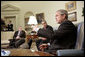 President George W. Bush and Zalmay Khalilzad, U.S. Ambassador to Iraq, meet with the press in the Oval Office Thursday, July 6, 2006. White House photo by Eric Draper