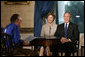 President George W. Bush and Laura Bush join CNN's Larry King at an interview Thursday, July 6, 2006 in the Blue Room at the White House. White House photo by Eric Draper