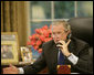 President George W. Bush speaks to Russian President Vladimir Putin during a morning telephone call Thursday, July 6, 2006, from the Oval Office of the White House. White House photo by Kimberlee Hewitt