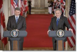 "President George W. Bush and Canadian Prime Minister Stephen Harper hold a joint press conference in the East Room Thursday, July 6, 2006. ""The President and I have agreed to task our officials to provide a more forward-looking approach focused on the environment, climate change, air quality and energy issues in which our governments can cooperate,"" said Prime Minister Harper. ""We raised the issue of how regulatory cooperation could increase productivity, while helping to protect our health, safety, and environment."" White House photo by Kimberlee Hewitt"