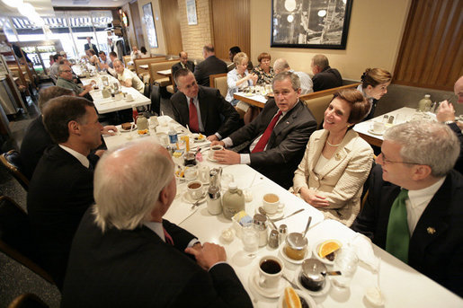 President George W. Bush meets local business leaders for breakfast at Lou Mitchell's Restaurant in Chicago, Friday, July 7, 2006. White House photo by Eric Draper