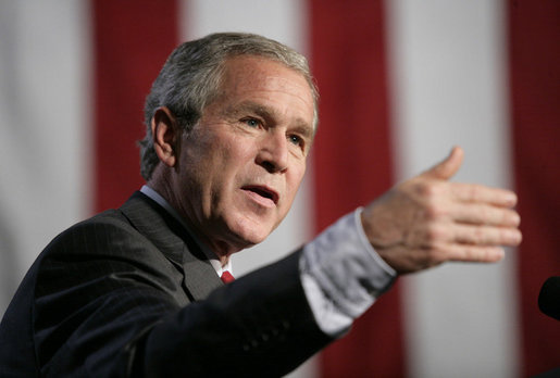 President George W. Bush gestures as he addresses a news conference at the Museum of Science and Industry in Chicago, Friday, July 7, 2006, speaking on the economy, immigration reform and security issues. White House photo by Eric Draper