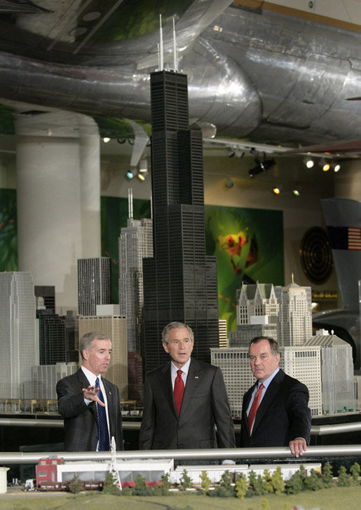 President George W. Bush is joined by Chicago Mayor Richard M. Daley, right, and Kurt Haunfelner, vice president of exhibits, left, as he is given a tour through the Museum of Science and Industry in Chicago, Friday, July 7, 2006, following his news conference at the museum. White House photo by Eric Draper