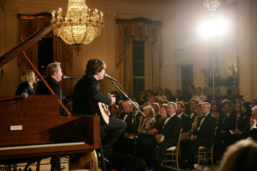 President George W. Bush, Mrs. Laura Bush and guests listen to the band Rascal Flatts in the East Room of the White House following a dinner honoring the Special Olympics and founder Eunice Kennedy Shriver, Monday, July 10, 2006. White House photo by Shealah Craighead
